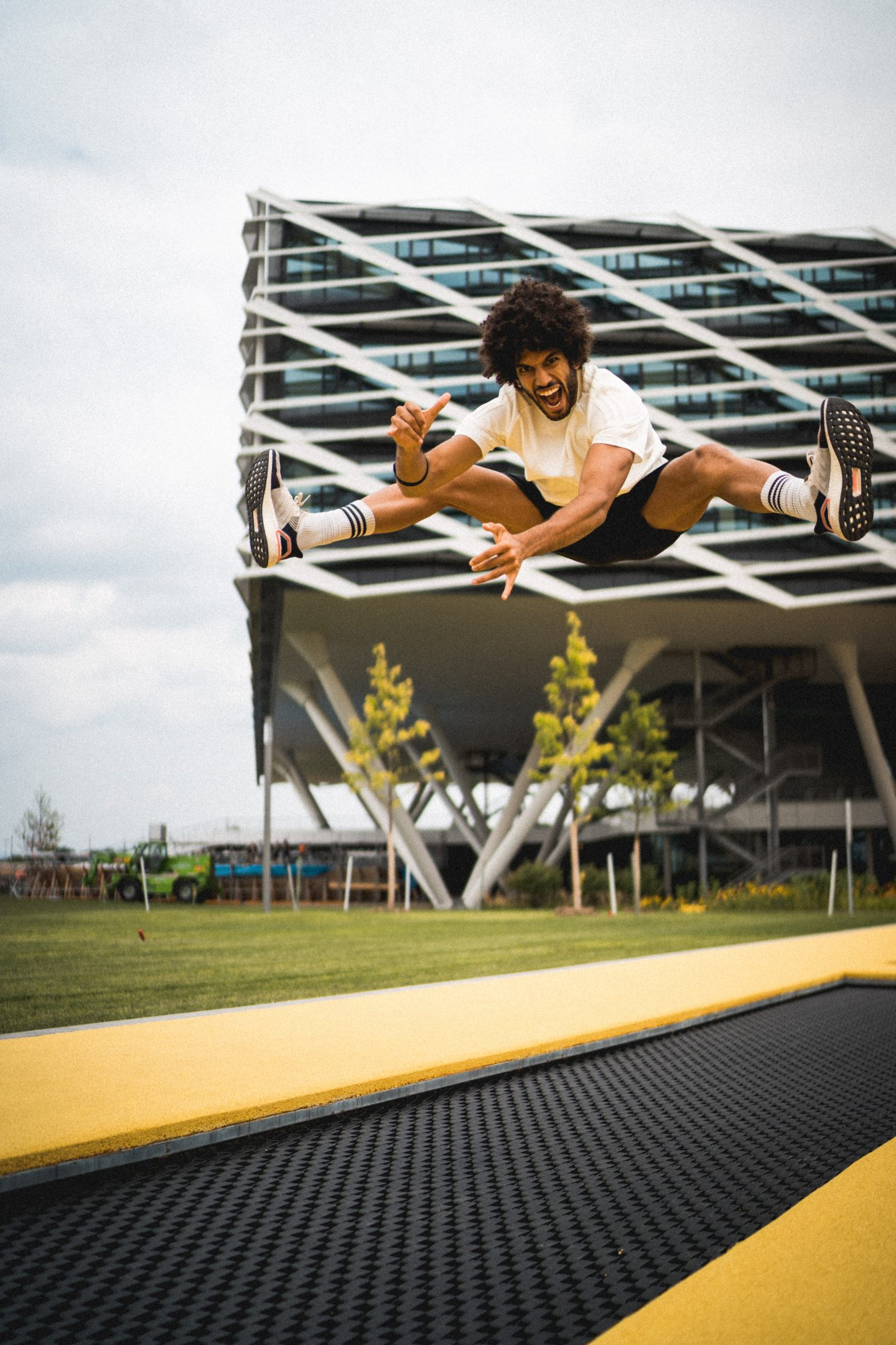Adidas runners captain with sneakers afro jumping on trampoline showing diversity in the workplace culture at adidas headquarters Herzogenaurach