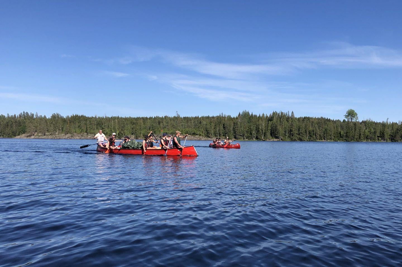 Six people in a canoe.