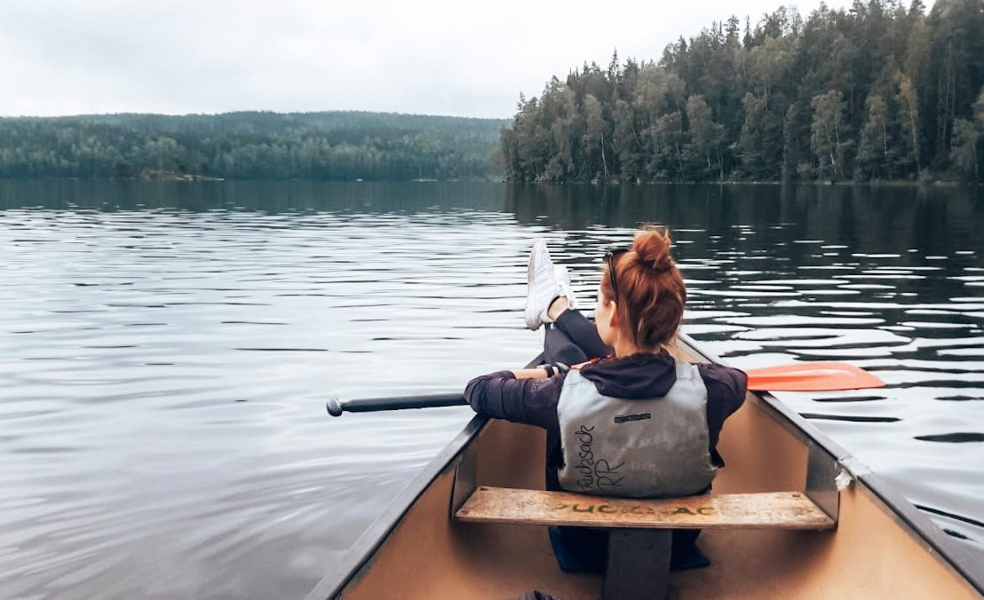 Woman sitting in boat taking in the views.