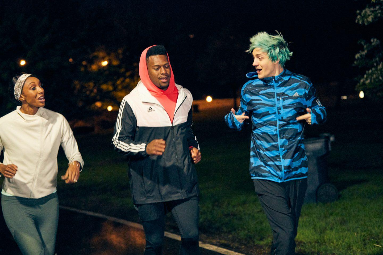 Maria Taylor runs with JuJu and Ninja at night.
