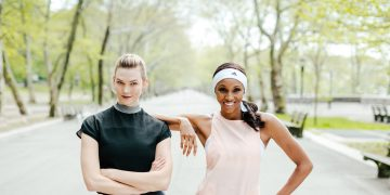 Maria Taylor and Karlie Kloss pose next each other in a park wearing adidas spots clothes.
