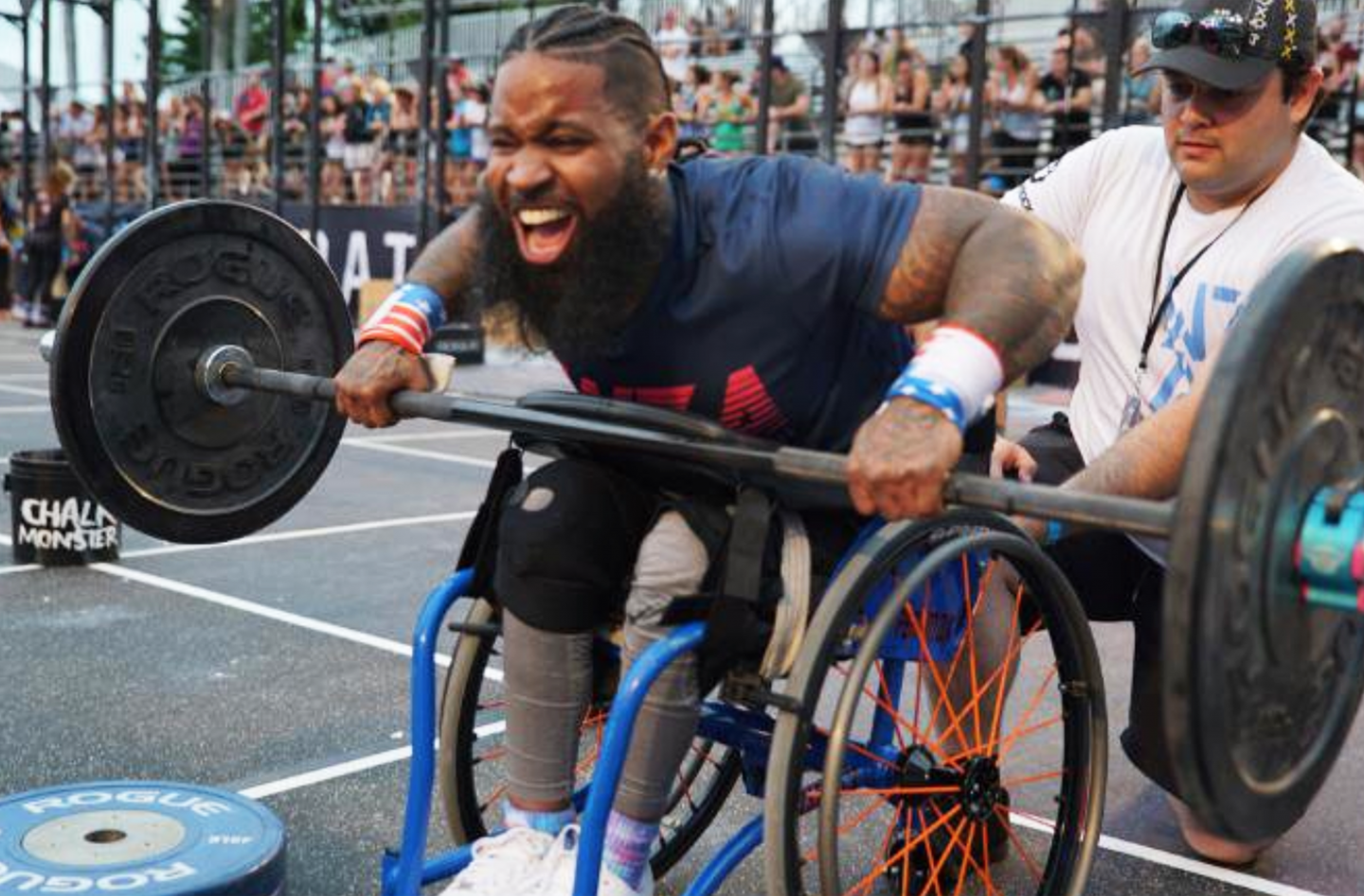 Wesley Hamilton lifts weights in his wheelchair at a competition.