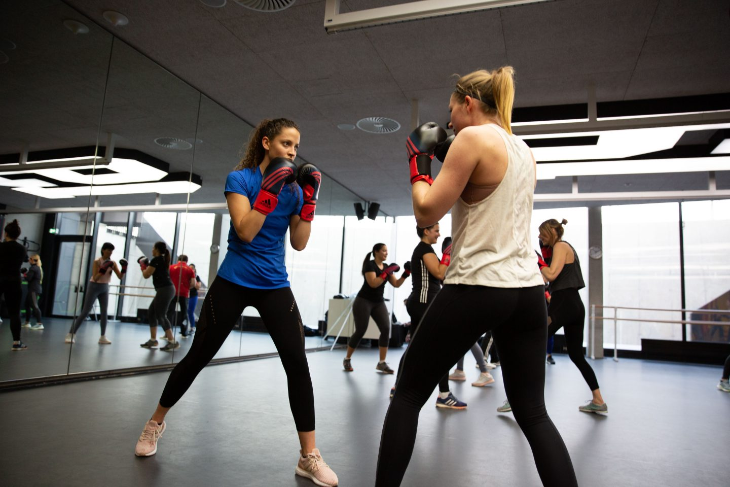 two women boxing in a female boxing class