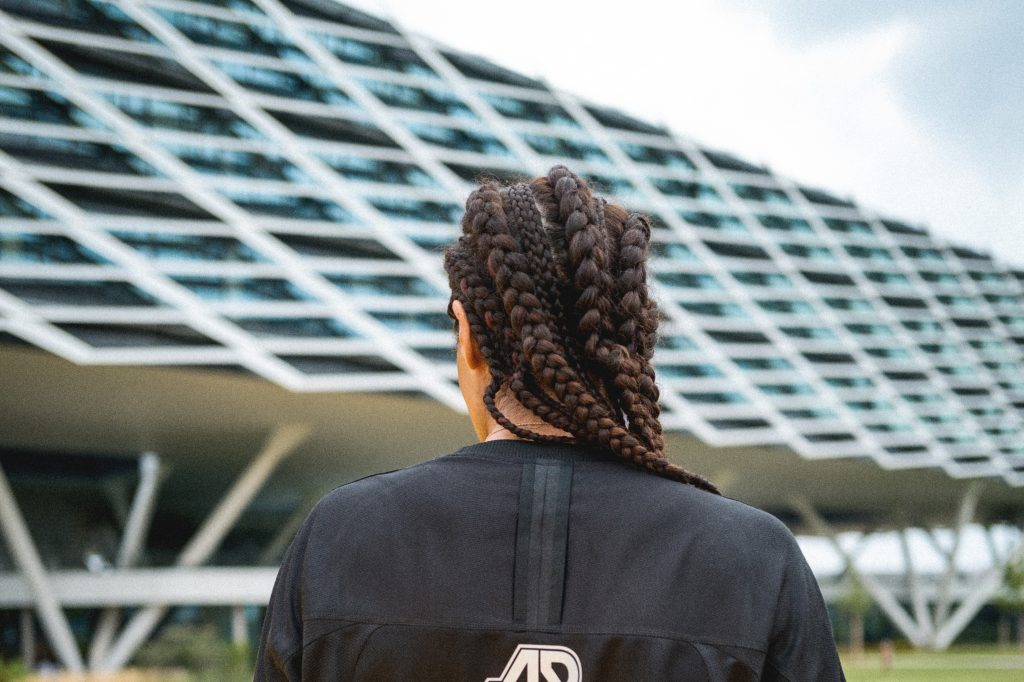 Women standing in front of adidas' Arena building