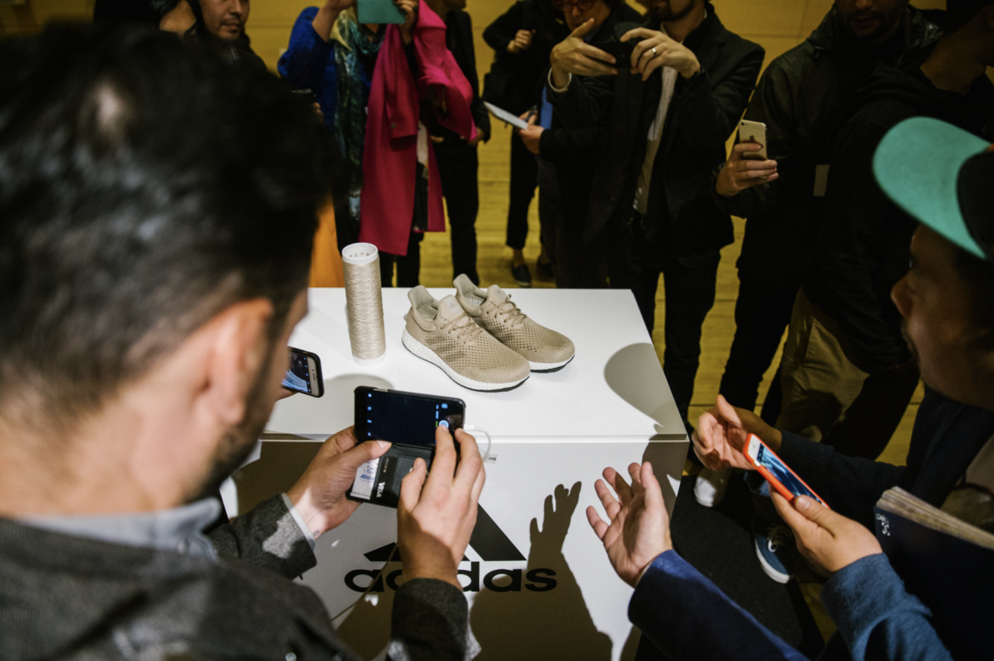 people taking picture of shoe biofabricate for better future