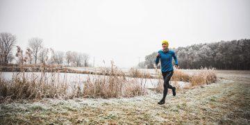 man running next to lake winter last run of the year