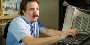 desperate looking man in front of computer why too much research is holding you back