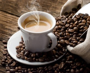 cup of coffee and coffee beans quitting caffeine