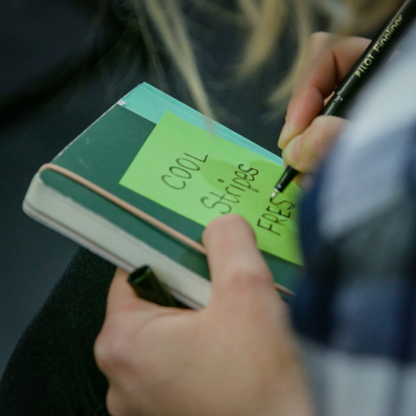 notebook with post its making the right hire