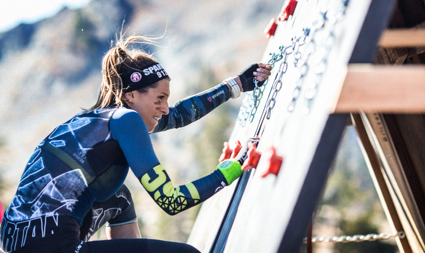 woman climbing wall spartan race laury thilleman