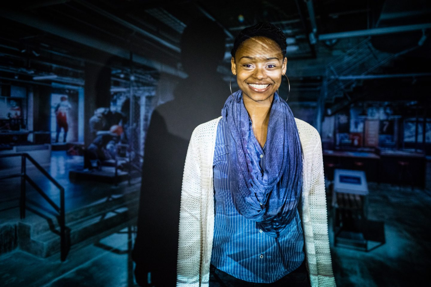 woman smiling with projection behind her