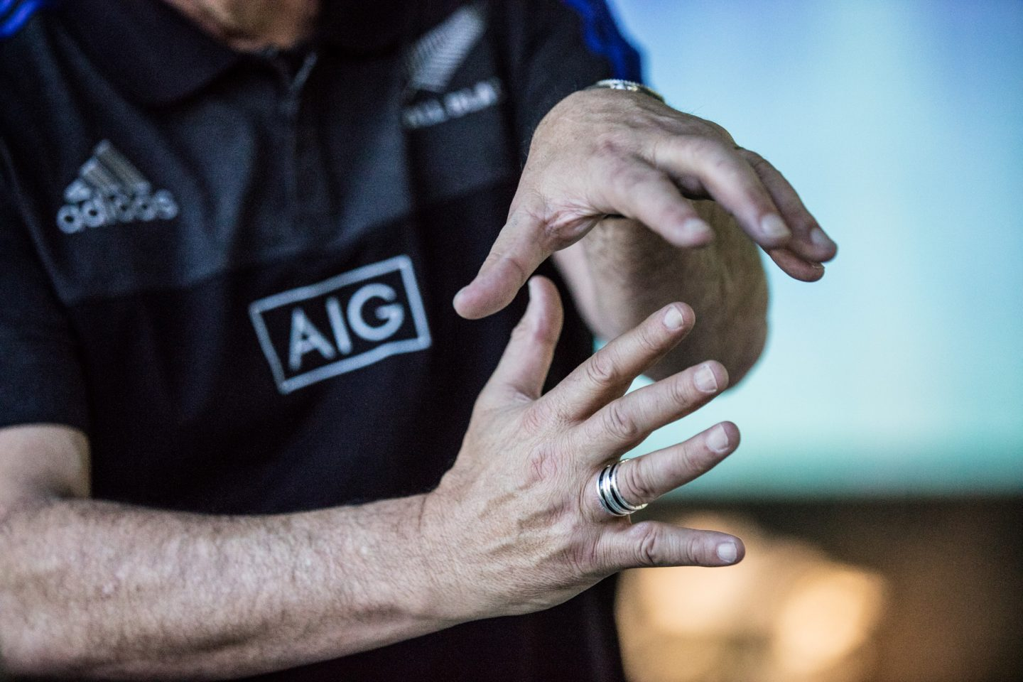 Hands with ring gesturing All Blacks Mental Coach Gilbert Enoka talking Mental Strength Vulnerability Team Spirit