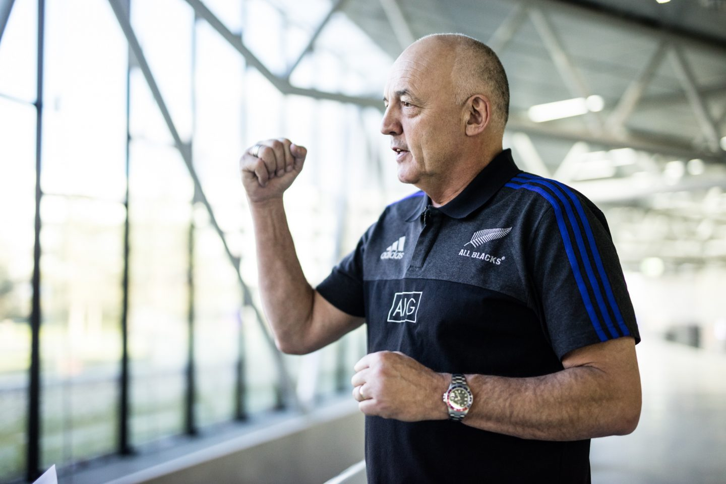 Man gesturing during interview adidas All Blacks Mental Coach Gilbert Enoka talking mental strength vulnerability team spirit