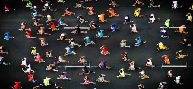 Many runners in the street during a marathon What Marathoners can teach you about achieving goals