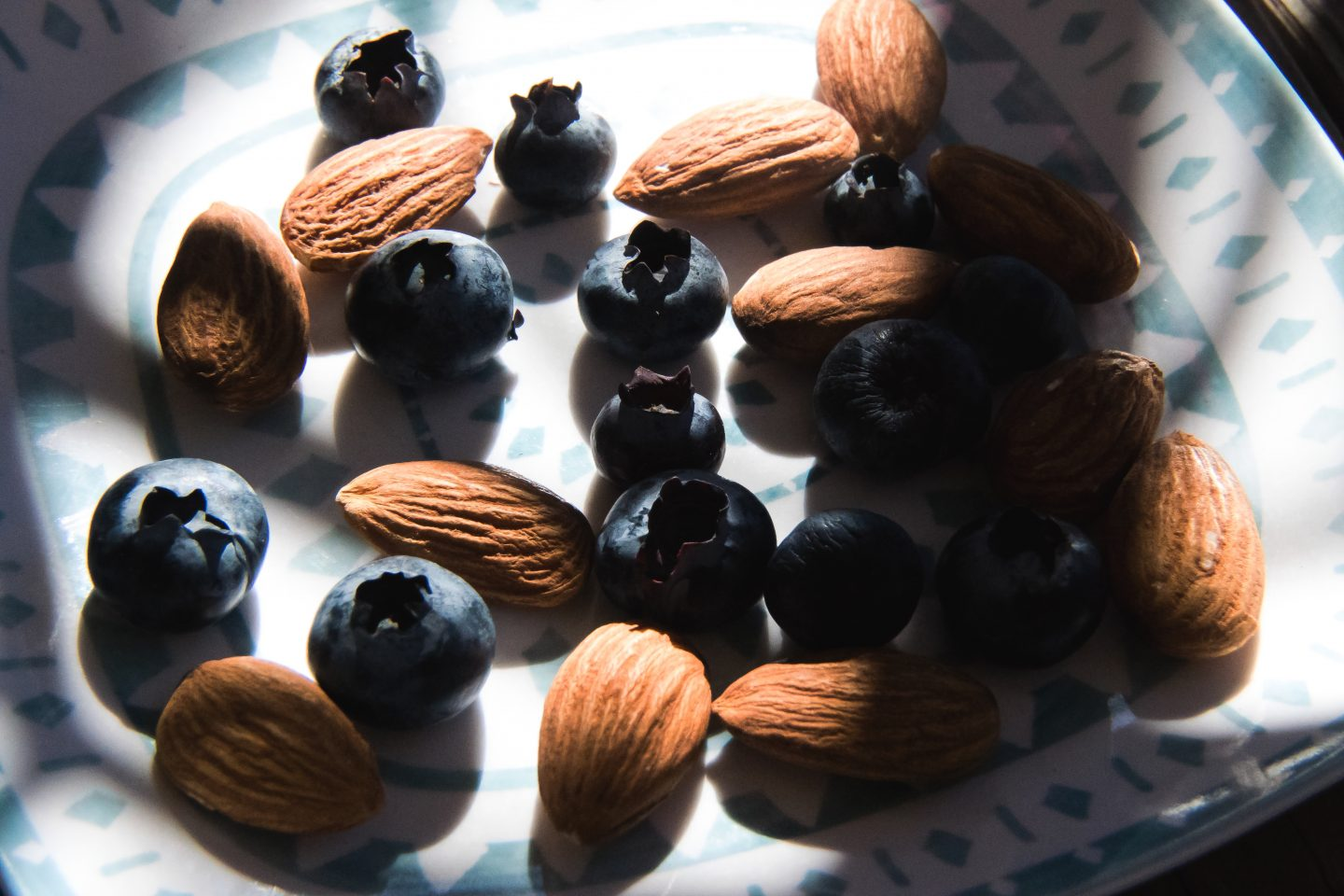 Close-Up Of Almonds And Blueberries On Plate