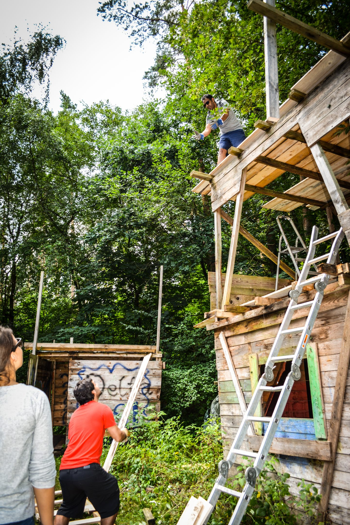 two guys working on a treehouse
