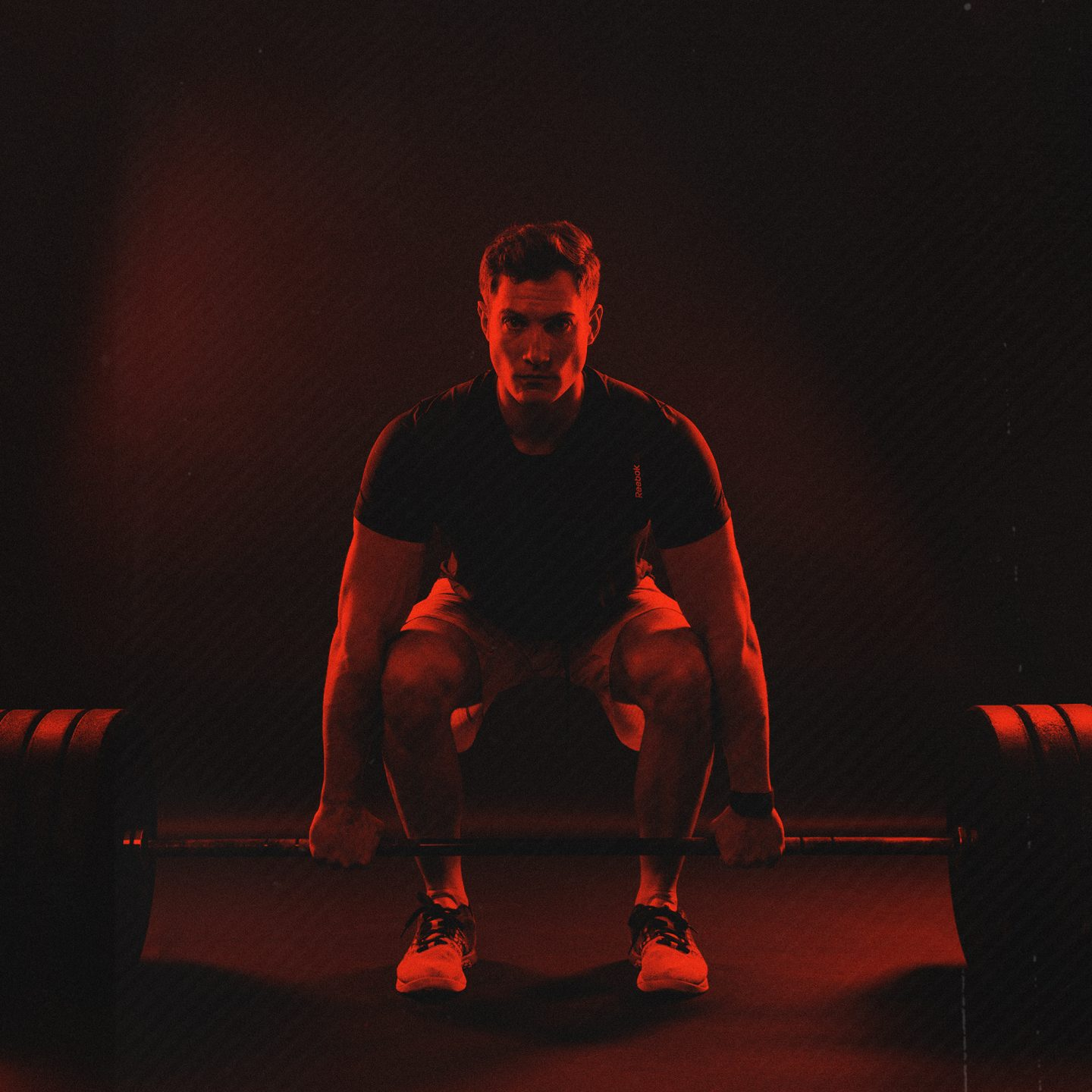 crossfitter focused weightlifting starting position red filter