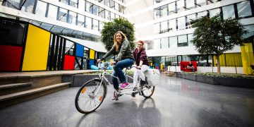 Two Women riding Tandem Job Sharing at its best interview adidas