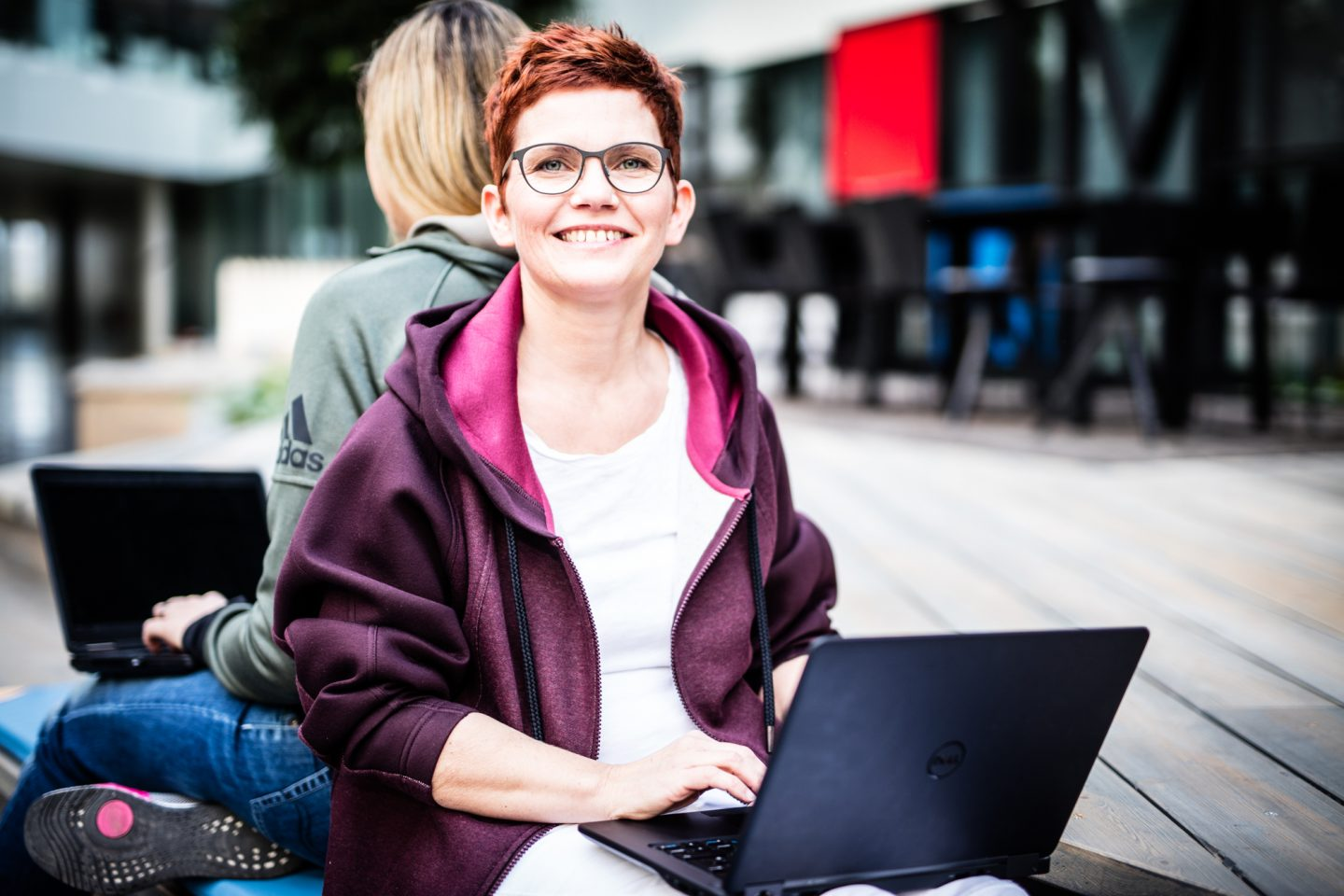 Woman with Laptop smiling Job Sharing at its best interview adidas
