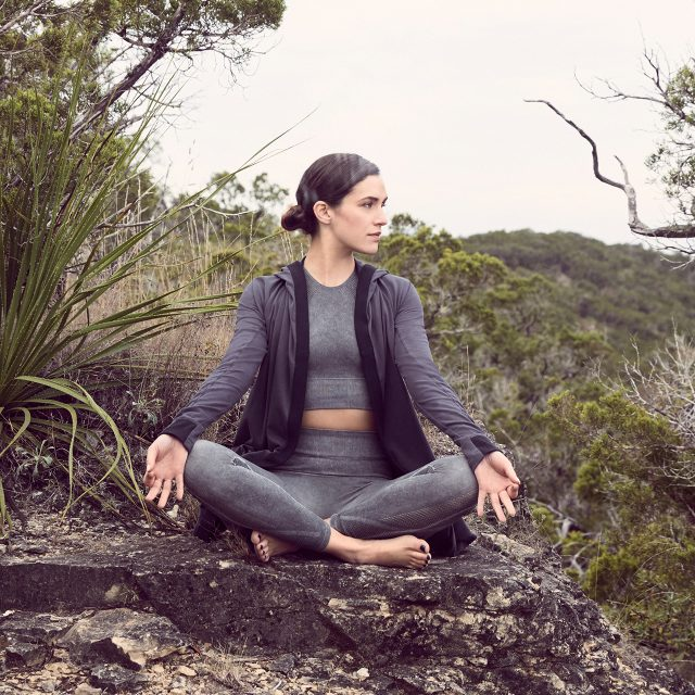 Woman doing yoga in the nature adriene mishler yoga power of conscious language