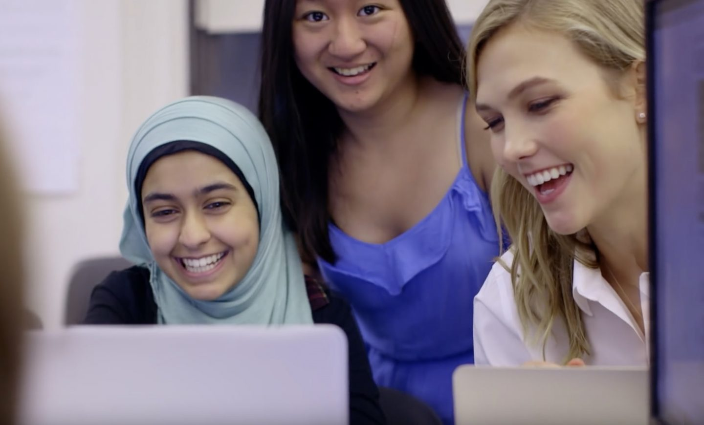 Girls coding happily with Karlie Kloss kode with klossy interview international women's day