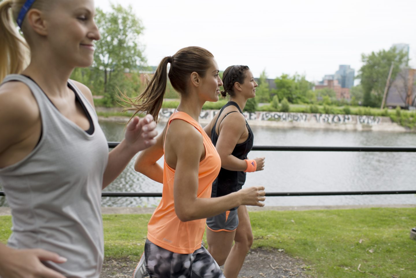 Three women running in nature next to a river. adidas partner workout, women running group, future trends, fitness, well-being, health, Future Fit Forecast 2017