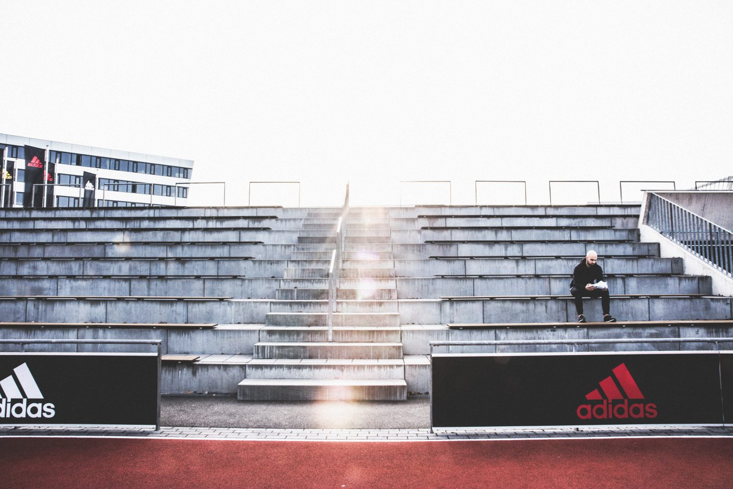 man sitting alone on stairs in a stadium how to finally start doing what you love