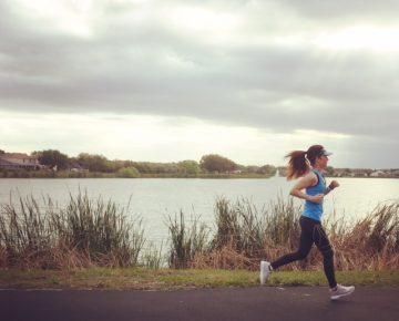Woman running at lake, Reebok, Mental