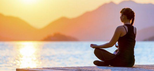 Woman meditation at lake, sunrise, morning