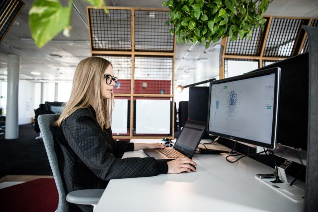 woman sitting in front of laptop female trainee digital commerce tec marketing