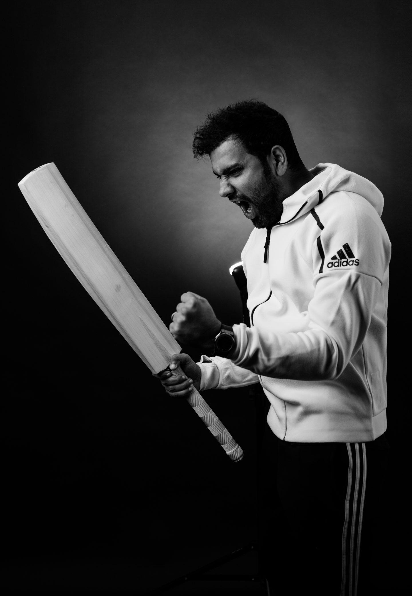 man with cricket bat celebrating rohit sharma cricket history win captain gameplanA interview