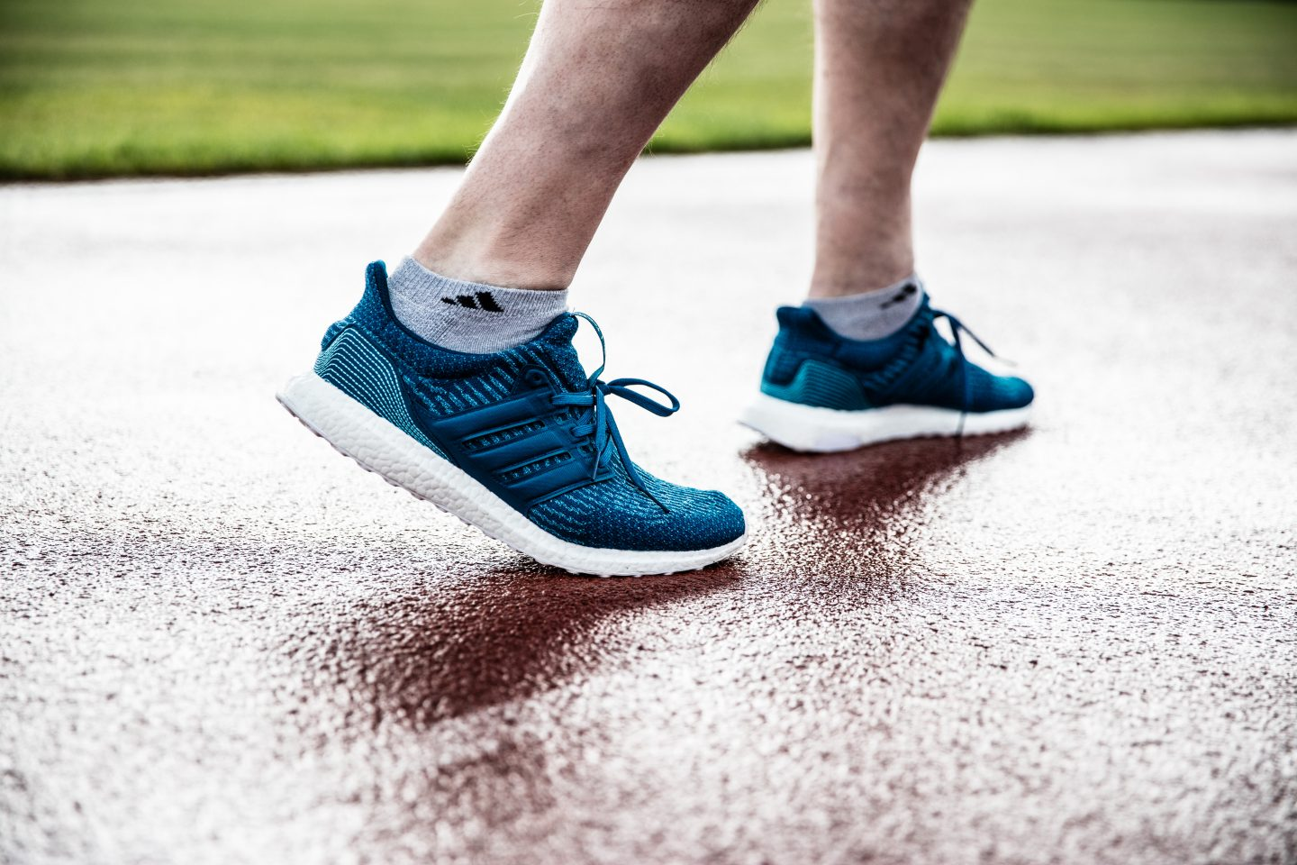 adidasRunning shoes UltraBOOST close up on running track; parley-running-for-the-oceans-boost-shoes-André-Maestrini-adidas-Running-GM