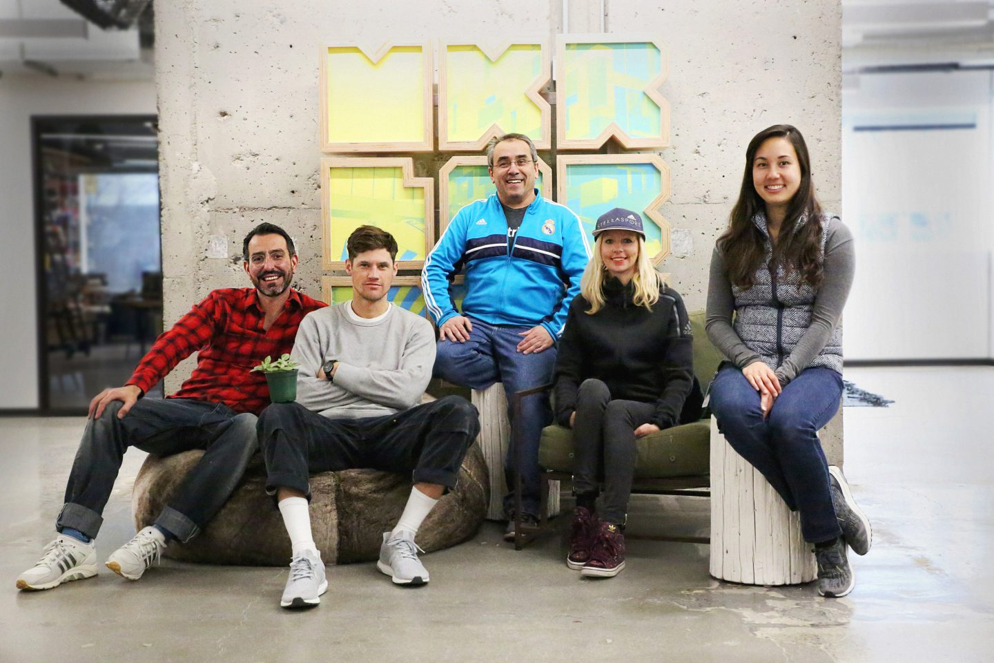Group of creative employees sitting on a sofa in adidas Portland office; adidas-Gameplan a-makerlab-PDX-Portland-team-creativity-employees-creators
