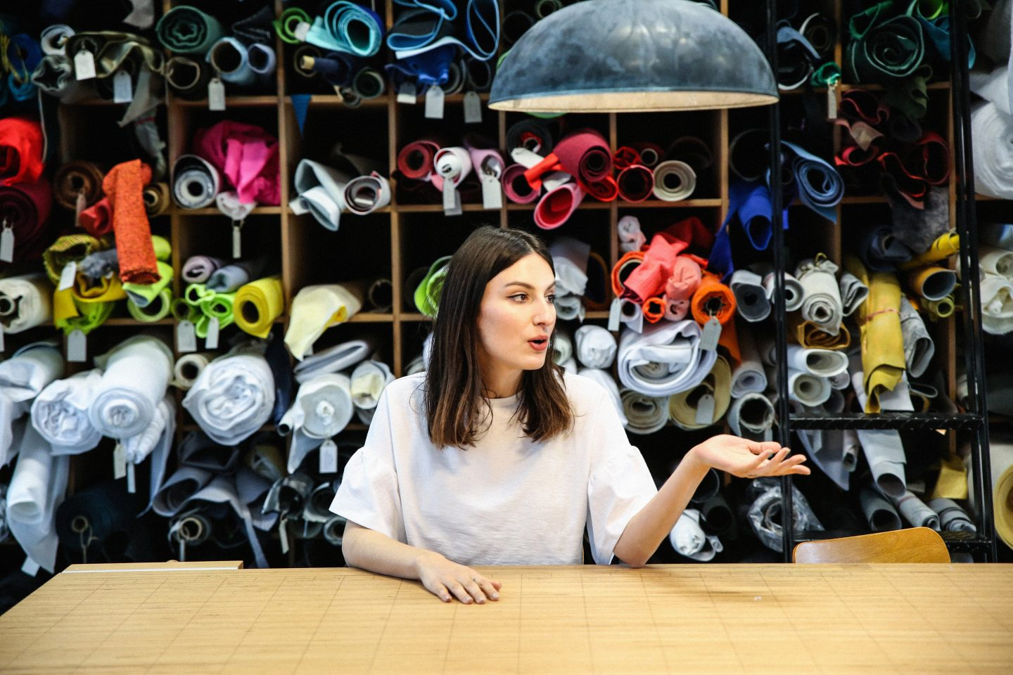 Woman sitting in front of materials, adidas creative office environment; adidas-Makerlab-creativity-employees-creators-Federica Tedeschi-Senior Material Designer-Brand Creative Direction