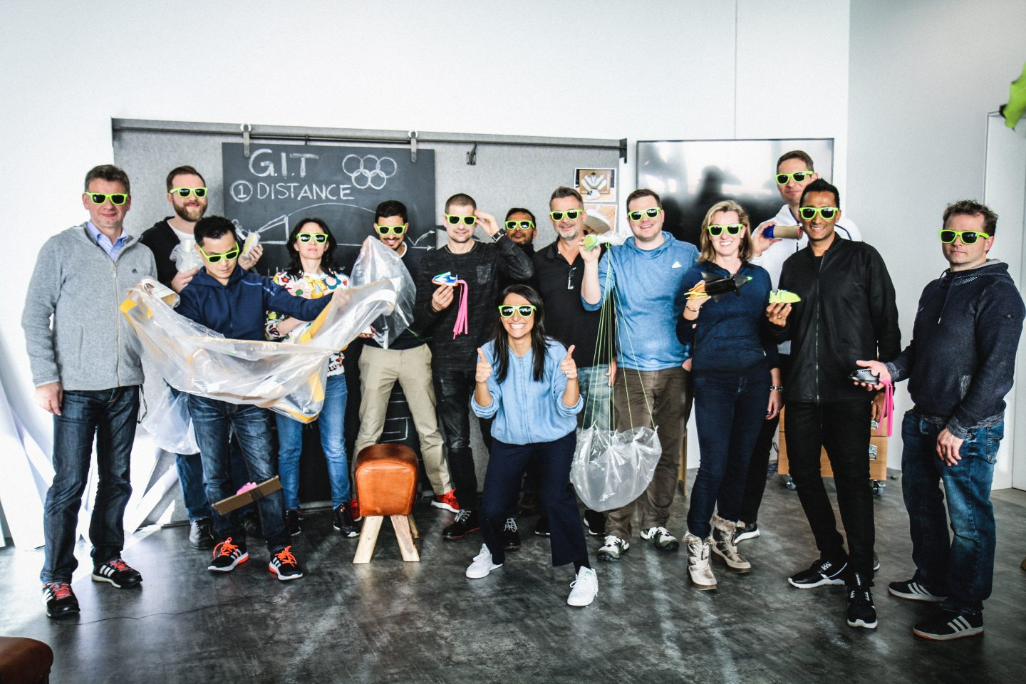 Group of people with sunglasses; adidas-Makerlab-creativity-employees-creators- IT-department-workshop