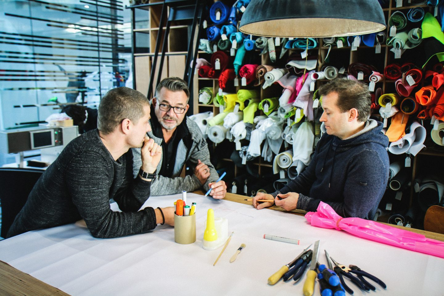 adidas employees discussing ideas; adidas-Makerlab-creativity-employees-creators- IT-department-workshop