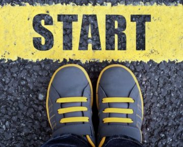 Grey yellow shoes starting line