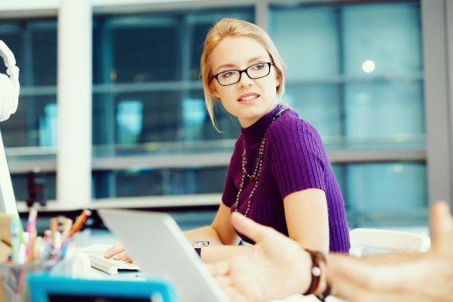 Woman wearing glasses meeting situation time management productivity