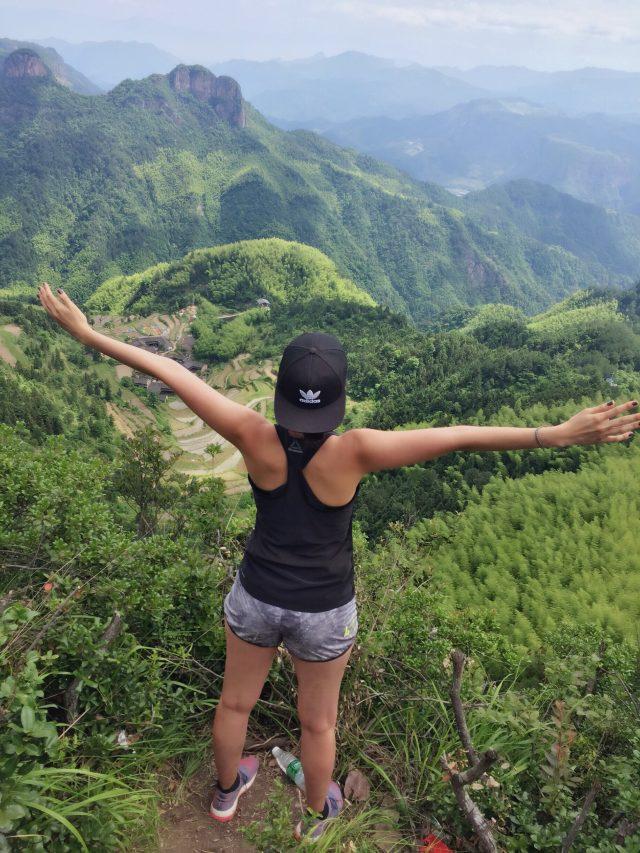 woman hiking mountains shanghai experience trainee