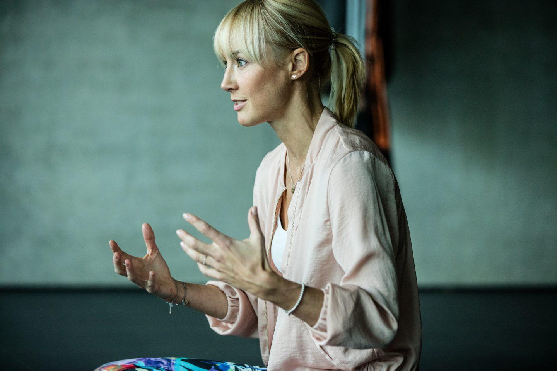 blonde woman gesturing anna kleb reebok yoga entrepreneur