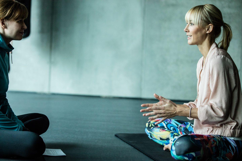 two women sitting in gym talking anna kleb reebok yoga entrepreneur
