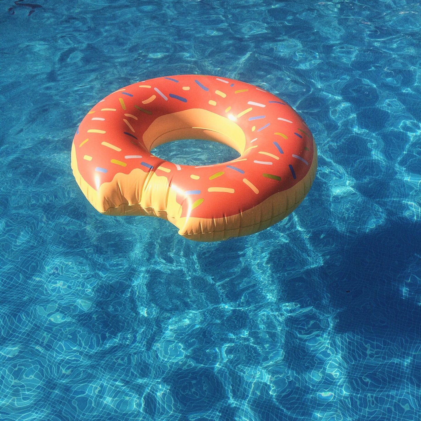 Close-Up Of Donut Shaped Inflatable Ring On Swimming Pool adidas GamePlan A Working outside