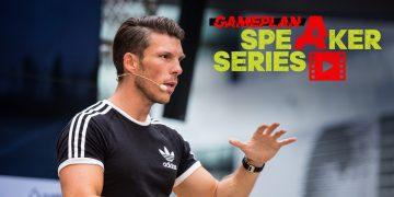 Runtastic CEO Florian Gschwandtner wearing black t-shirt talking on stage, Runtastic CEO_entrepreneur_career_talk_adidas_GamePlan A