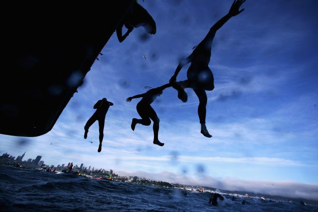 Escape From Alcatraz Triathlon_people jumping into the sea_sunrise