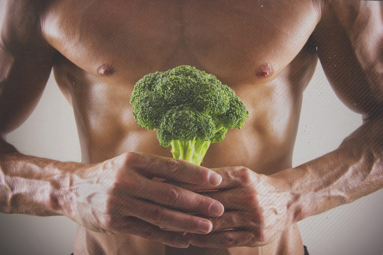 Muscular Caucasian athlete holding broccoli, nutrition, health, adidas, GamePlan A