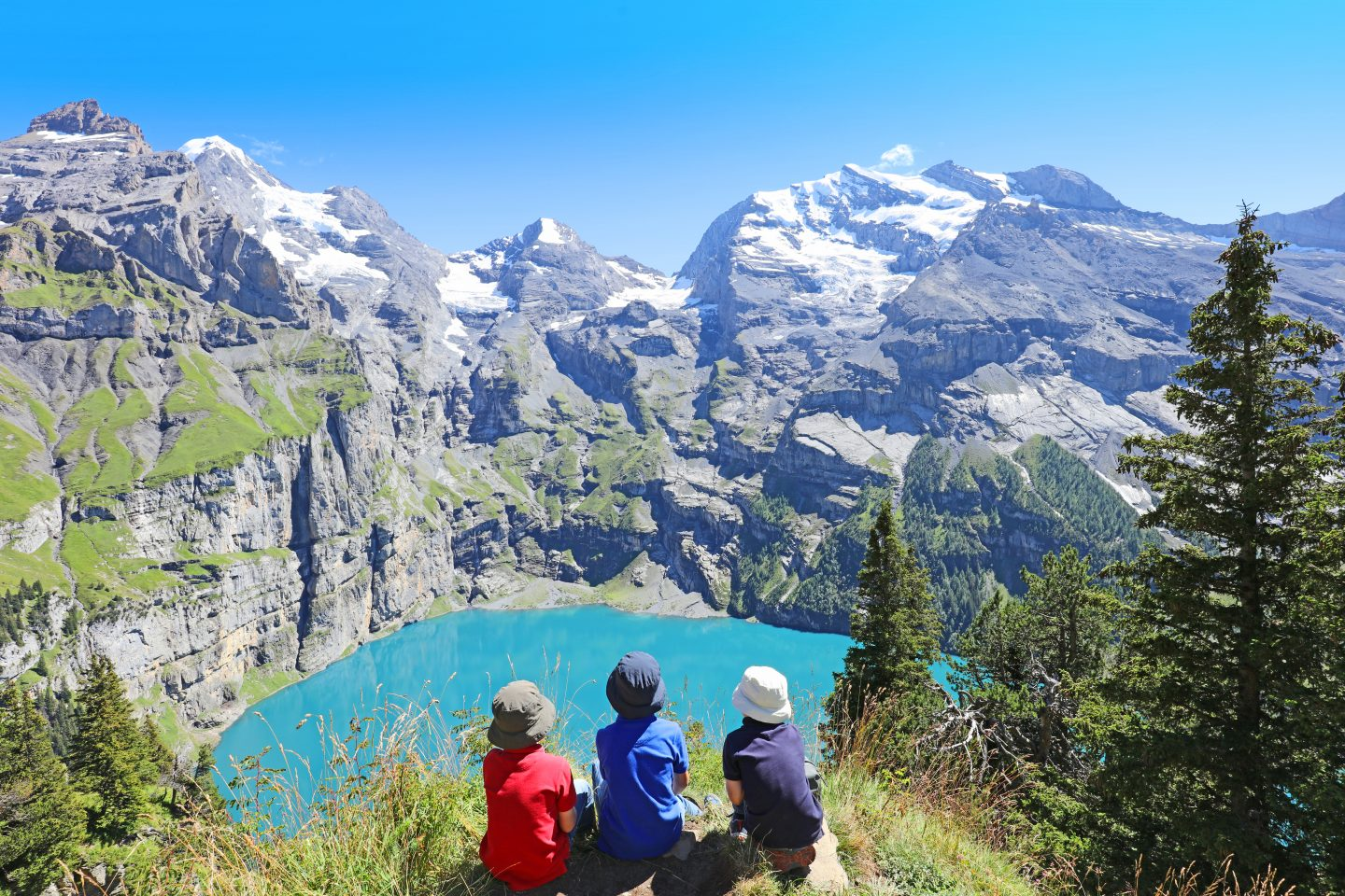 Children Hiking in Swiss Mountains Admiring Scenic Landscape at Oeschinensee