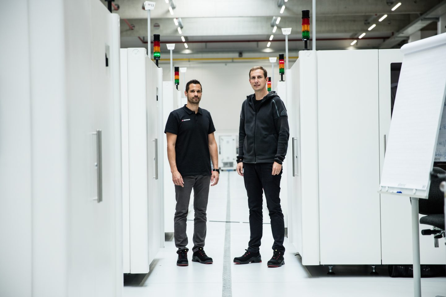 Engineers standing between machines in a factory, adidas-SPEEDFACTORY-OECHSLER-interview-GamePlanA-machine