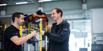 Two men standing in front of machines, adidas-SPEEDFACTORY-OECHSLER-interview-GamePlanA, engineering, customization