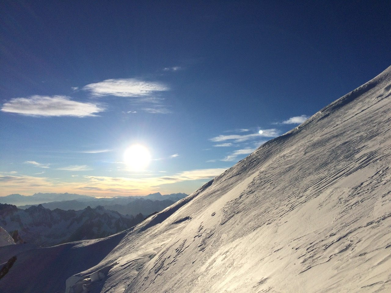 Part of a snowy mountain and the sun in the background, Mont Blanc_Snowy Mountain_Mountaineering_Landscape, adidas, GamePlan A, Marcus Leach, Risk Taking