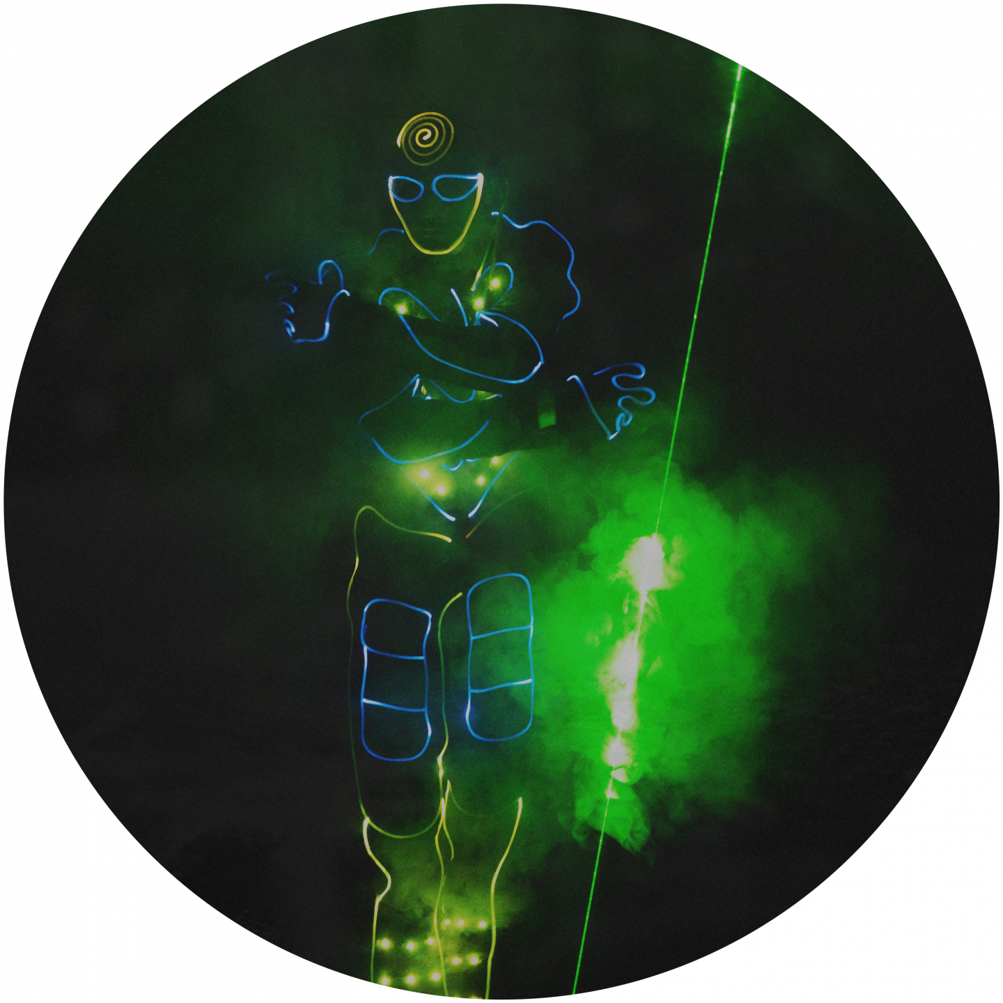 A man wearing neon lights moving through the dark with a green laser. team building, lasertag, light, neon, team, event, business, adidas, GamePlan A
